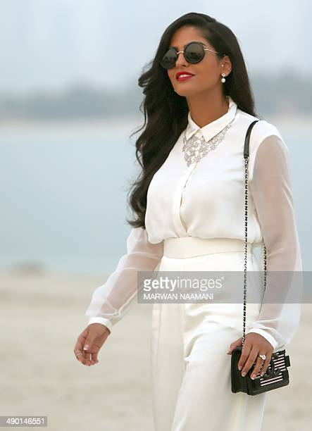 Saudi Princess Ameera alTaweel arrives to attend the Chanel 2015 Cruise runway collection at The Island in Dubai a man made island in the shape of a...