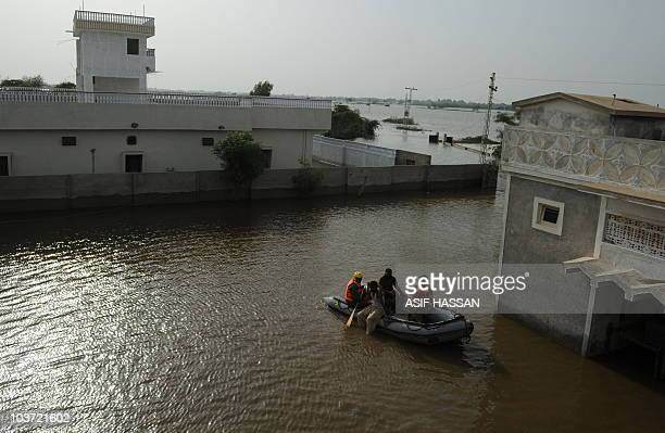 Saudi rescuers search for Pakistani flood survivors to distribute reliefs good in Wahid Soomro village in Thatta on August 29 2010 Torrential monsoon...
