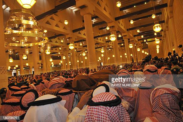 Saudi Royal family members and relatives the body of the late Saudi Crown Prince Sultan bin Abdel Aziz at Imam Turki bin Abdullah mosque on October...