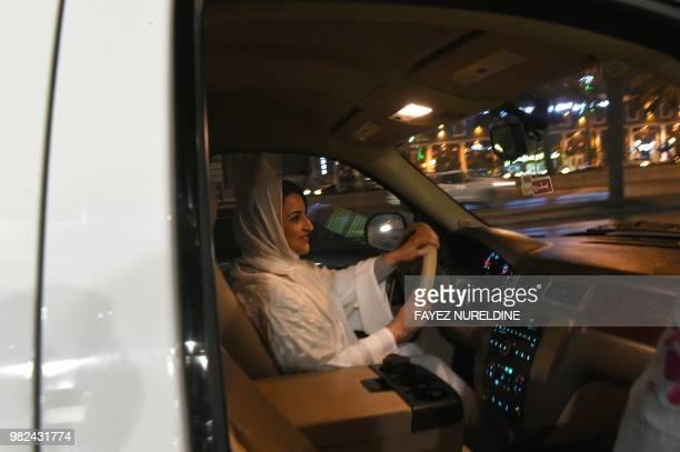 Saudi Samar Almogren drives her car through a main street of the Saudi capital Riyadh for the first time just after midnight June 24 when the law...