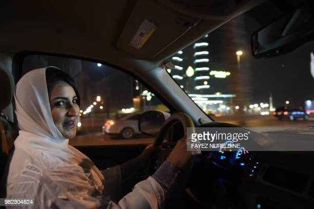 Saudi Samar Almogren drives her car through Riyadh city's streets for the first time just after midnight when the law allowing women to drive takes...