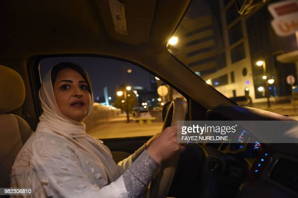 Saudi Samar Almogren drives her car through Riyadh city's streets for the first time just after midnight June 24 when the law allowing women to drive...