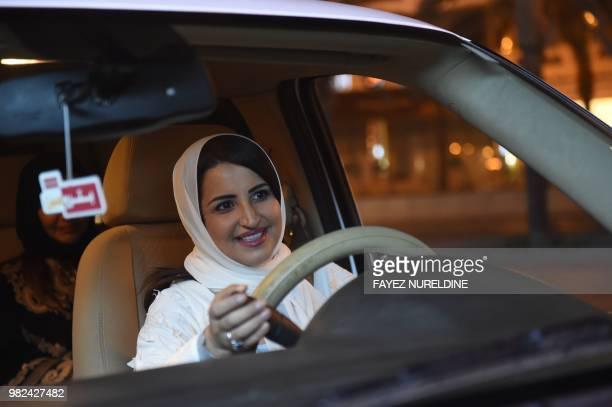 Saudi Samar Almogren drives her car through the streets of the Saudi capital Riyadh for the first time just after midnight June 24 when the law...
