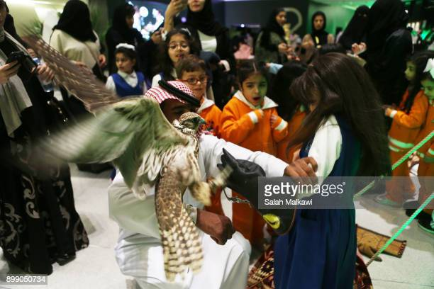 Saudi school children who were brought to watch a part of the chess shampionship and arriving with their mothers and teahers take memorial photos...