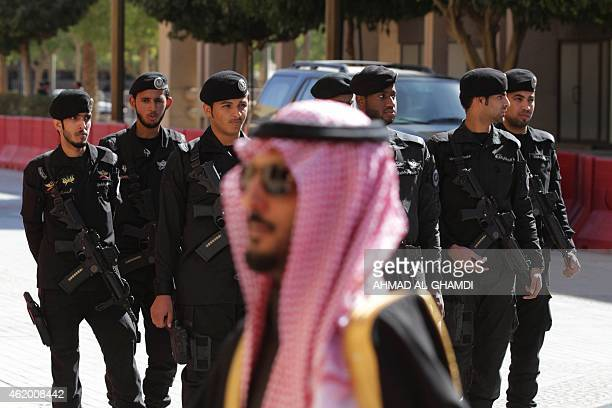 Saudi security forces keep watch during the funeral of late Saudi King Abdullah bin Abdul Aziz on January 23 2015 in Riyadh Foreign leaders gathered...