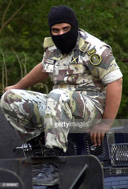 Saudi security forces member sits atop a military jeep during an attack on a house where militants were thought to be hiding after a fourth was...