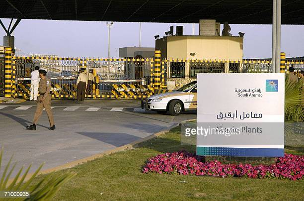 Saudi security guard the entrance of the oil processing plant of the Saudi state oil giant Aramco in Abqaiq in Saudi Arabia's oilrich Eastern...