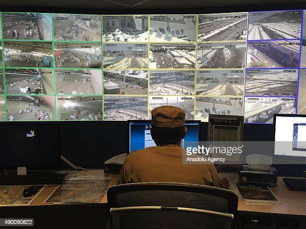 Saudi Security officer watches the security camera footages at the Security Center in Mecca Saudi Arabia on September 26 2015 Tight security measures...