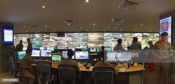 Saudi Security officers watch the security camera footages at the Security Center in Mecca Saudi Arabia on September 26 2015 Tight security measures...