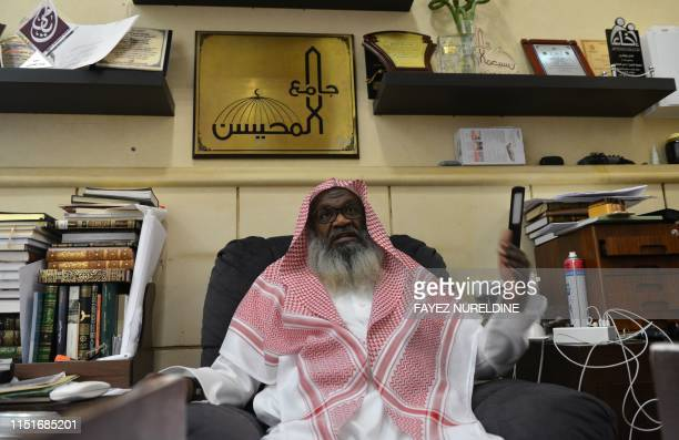 Saudi senior cleric Adel al-Kalbani speaks during an intreview with AFP at his office in a mosque in Riyadh, on June 18, 2019. - Wedding contracts in...