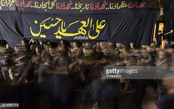 Saudi Shiite Muslim men take part in commemorations marking Ashura, in the Shiite-dominated Gulf coast city of Qatif, on October 12, 2016. Ashura...