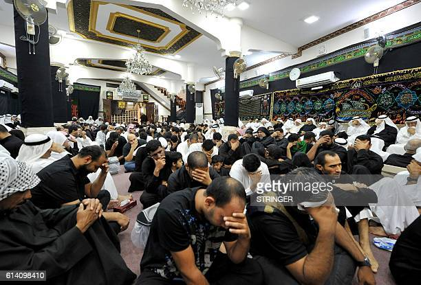 Saudi Shiite Muslim men take part in commemorations on the tenth day of the mourning period of Muharram, which marks the day of Ashura, on October 12...