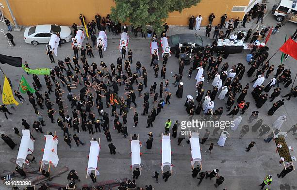 Saudi Shiite Muslims take part in a reenactment of the battle of Karbala on the tenth day of the mourning period of Muharram which marks the day of...