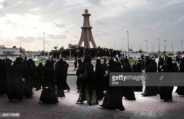 Saudi Shiite women and men take part in a protest in the eastern coastal city of Qatif against the execution of prominent Shiite Muslim cleric Nimr...