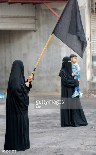 Saudi Shiite women hold black flags during a protest in the eastern coastal city of Qatif against the execution of prominent Shiite Muslim cleric...