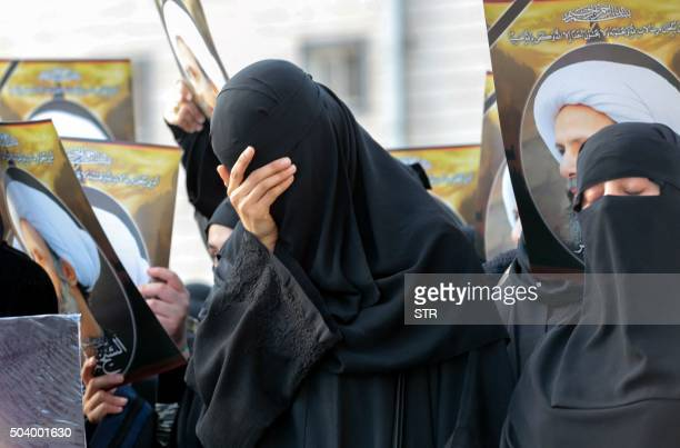 Saudi Shiite women react during a protest on January 8 2016 in the eastern coastal city of Qatif against the execution of prominent Shiite Muslim...