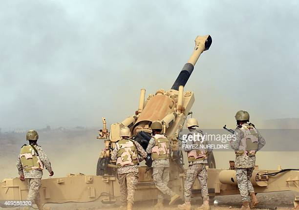 Saudi soldiers from an artillery unit fire shells towards Yemen from a post close to the SaudiYemeni border in southwestern Saudi Arabia on April 13...