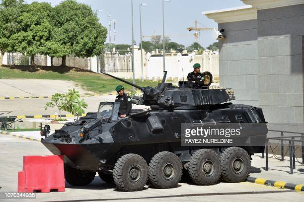Saudi soldiers in armoured vehicles guard the entrance to the Diriya Palace in the Saudi capital Ryadh during the Gulf Cooperation Council summit on...