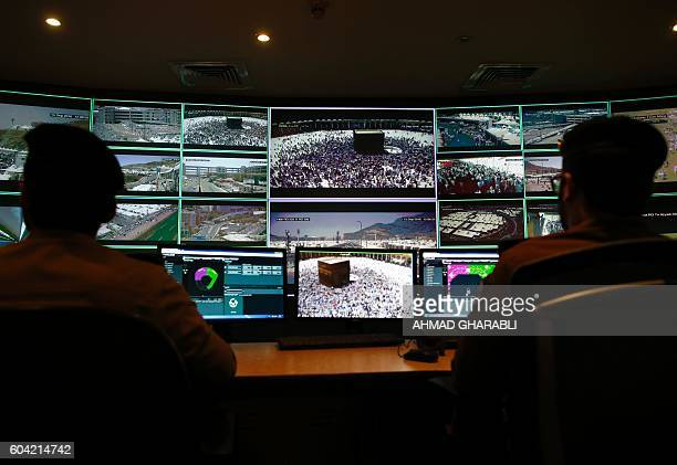Saudi soldiers monitor screens as they sit on duty at the command and control operation center in Mina near the holy city of Mecca on September 13...