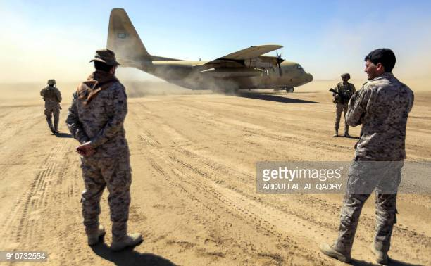 Saudi soldiers stand by as a Saudi Air Force cargo plane carrying humanitarian aid lands at an airfield in Yemen's northeastern province of Marib on...