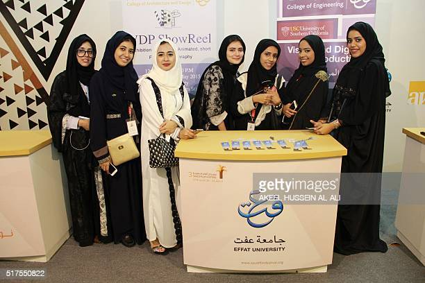 Saudi students from Effat University are seen at a booth promoting their Visual and Digital Production programme on March 25 2016 at the Saudi Film...