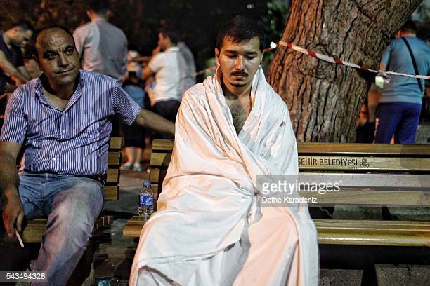 Saudi tourist who survived the Ataturk Airport suicide bomb attack waits for his wounded mother outside the Bakirkoy Sadi Konuk Hospital in the early...