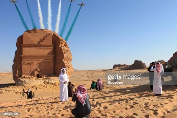 Saudi visitors watch an aerial flying display over Mada'in Saleh, a UNESCO World Heritage Site, in Mada'in Saleh, Saudi Arabia, on Tuesday, Jan. 31,...