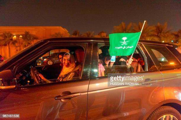 A Saudi woman and her friends celebrate her first time driving on a main street of Khobar City on her way to Kingdom of Bahrain on June 24 2018 Saudi...