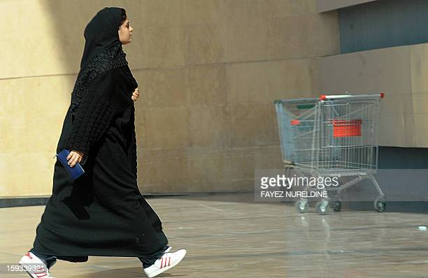 A Saudi woman arrives at a shopping mall in Riyadh on January 12 2013 Saudi King Abdullah has appointed women for the first time to a top advisory...