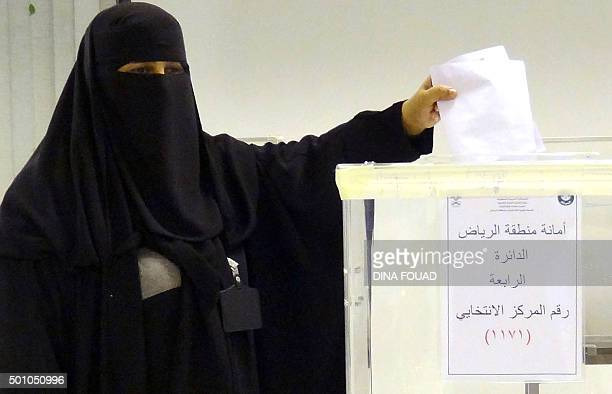 A Saudi woman casts her ballot in an election centre in the Saudi capital of Riyadh on December 12 2015 Saudi women were allowed to vote in elections...