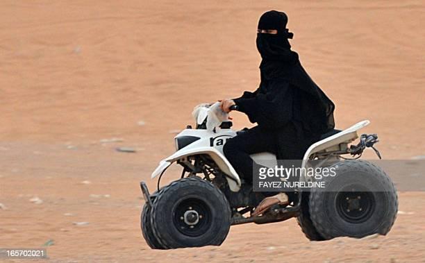 A Saudi woman drives an ATV at Thumamah Park near Riyadh on April 5 2013 Saudi Arabia's religious police have lifted a ban on women riding bicycles...