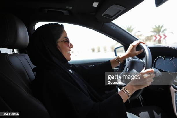 A Saudi woman drives an automobile along a highway after obtaining her official driving licence in Riyadh Saudi Arabia on Monday June 25 2018 Lifting...