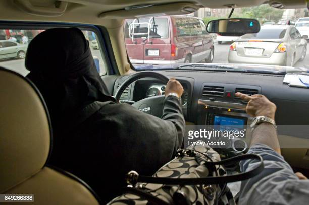 Saudi woman drives in Riyadh Saudi Arabia while accompanied by her husband during a call for women to come out and drive in a protest against the...