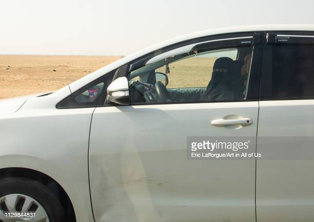 Saudi woman driving alone in a car on the highway Mecca province Jeddah Saudi Arabia on December 15 2018 in Jeddah Saudi Arabia