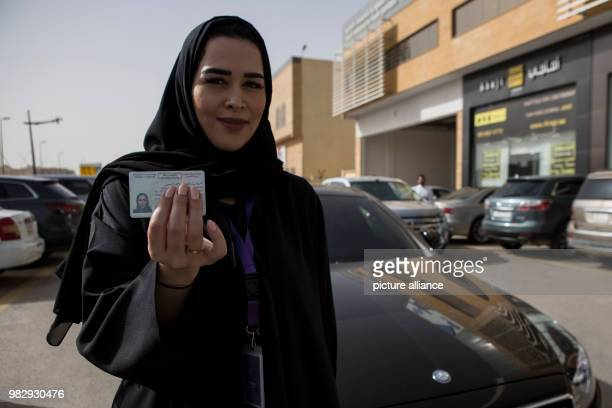 Saudi woman Gamela Aldakhel poses with her new Saudi driving license on the first day after lifting the driving ban on women 24 June 2018 Women in...