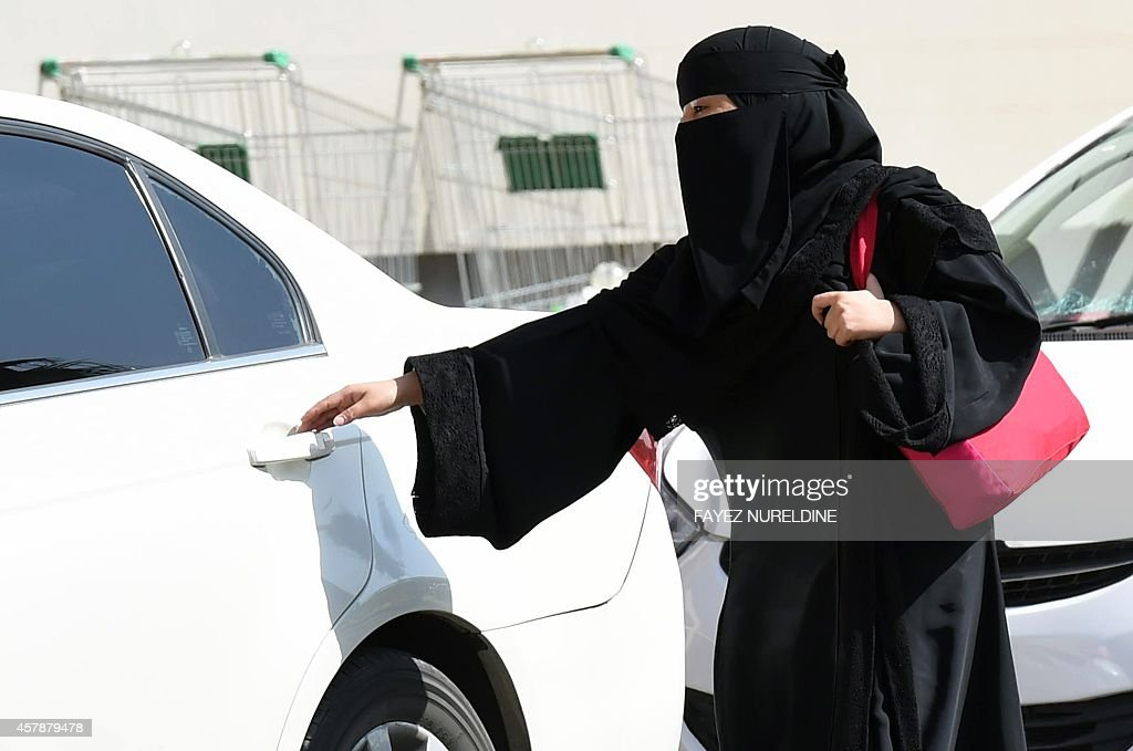 A Saudi woman gets into a taxi at a mall in Riyadh as a grassroots campaign planned to call for an end to the driving ban for women in Saudi Arabia on October 26, 2014. Amnesty International is calling on the Saudi Arabian authorities to respect the right of women to defy the ban by driving this weekend and to end the harassment of supporters of the campaign.