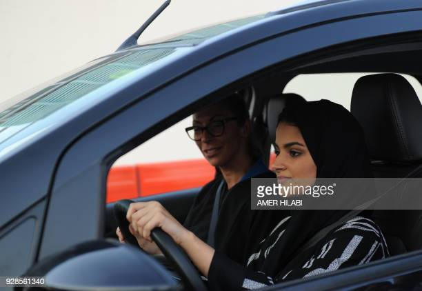 A Saudi woman has a driving lesson in Jeddah on March 7 2018 Saudi Arabia's historic decision in September 2017 to allow women to drive from June has...