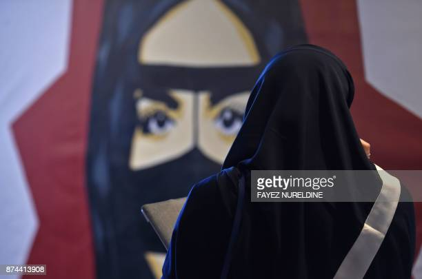 A Saudi woman looks at a painting during the 'MiSK Global Forum' held under the slogan 'Meeting the Challenge of Change' in Riyadh on November 15...