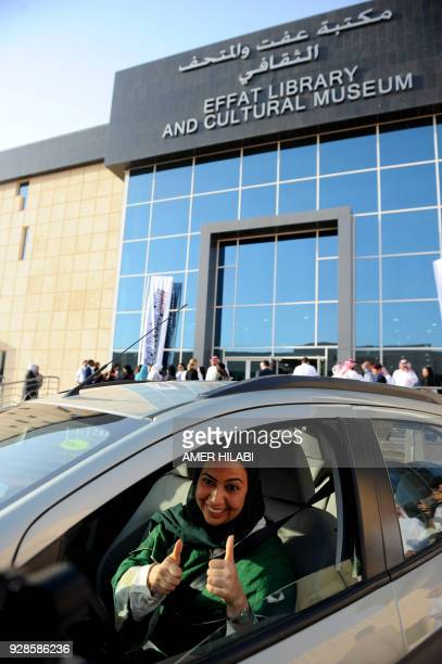 A Saudi woman poses for a photo after having a driving lesson in Jeddah on March 7 2018 Saudi Arabia's historic decision in September 2017 to allow...