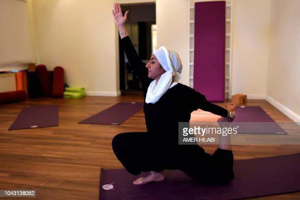 A Saudi woman practices yoga at a studio in the western Saudi Arabian city of Jeddah on September 7 2018 Widely perceived as a Hindu spiritual...