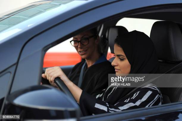 A Saudi woman receives a driving lesson from an Italian instructor in Jeddah on March 7 2018 Saudi Arabia's historic decision in September 2017 to...