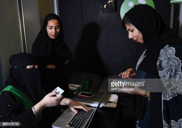 A Saudi woman registers to take part in a training programme for new female drivers at Careem a chauffeur driven car booking service at their Saudi...