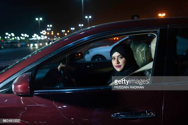 Saudi woman Sabika Habib drives her car through the streets of Khobar City on her way to Kingdom of Bahrain For the first time little after midnight...