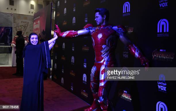 A Saudi woman shares a light moment at a cinema theatre in Riyadh Park mall after its opening for the general public on April 30 2018 in the Saudi...