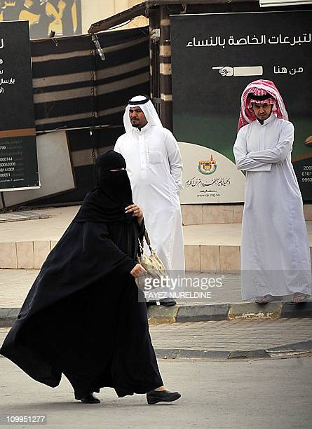 Saudi woman walks near 'AlRajhi mosque' in central Riyadh on March 11 2011 as Saudi Arabia launched a massive security operation in a menacing show...