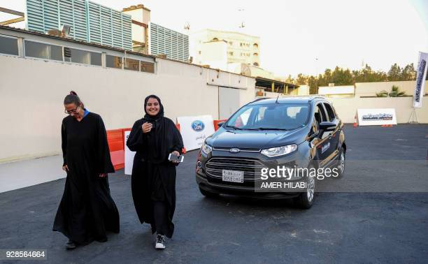 A Saudi woman walks with an Italian driving instructor during a lesson in Jeddah on March 7 2018 Saudi Arabia's historic decision in September 2017...
