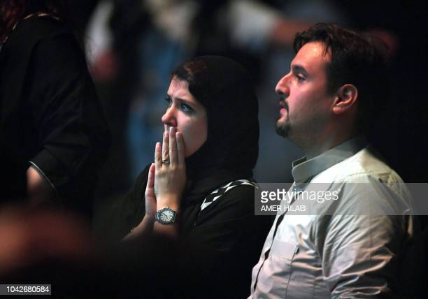 A Saudi woman watches as British boxers George Groves and Callum Smith box during the World Boxing Super Series SuperMiddleweight Ali Trophy Final at...