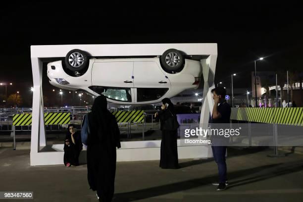 A Saudi woman wearing a black chador drives a gocart during an educational driving event at Riyadh Park Mall in Riyadh Saudi Arabia on Saturday June...
