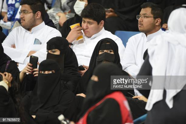 Saudi women and men attend the AFC Champions League group stage football match between Saudi Arabia's Al Hilal and UAE's Al Ain at King Saud...