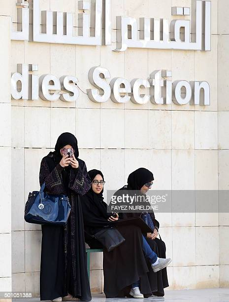 Saudi women are seen after casting their ballots at a polling station in the capital Riyadh on December 12 2015 during municipal elections Saudi...